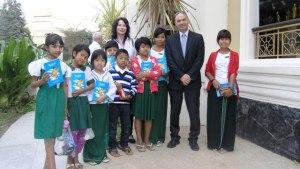 Israel Ambassador Hagay Behar and author Michal Snunit with children in Myanmar Photo: Embassy of Israel, Yangon.